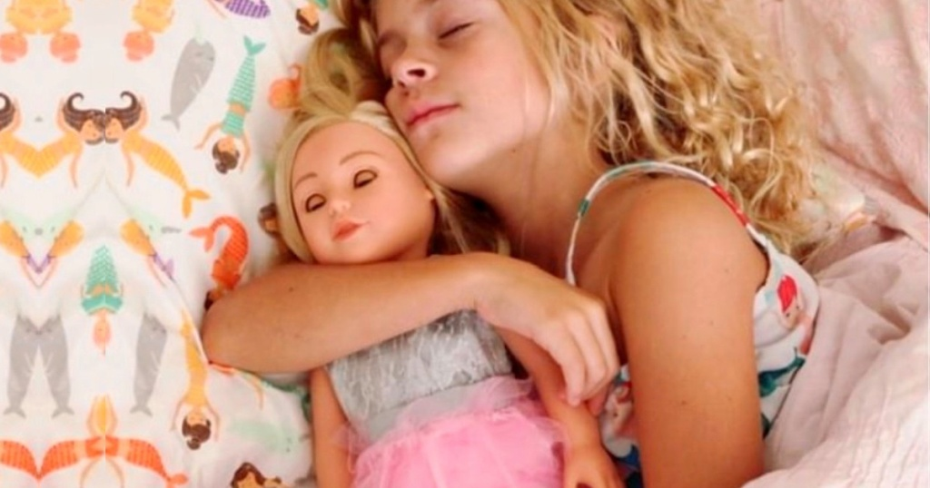 "little girl sleeping with an 18"" adora doll"