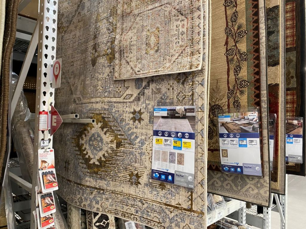 rugs hanging on display at Lowe's