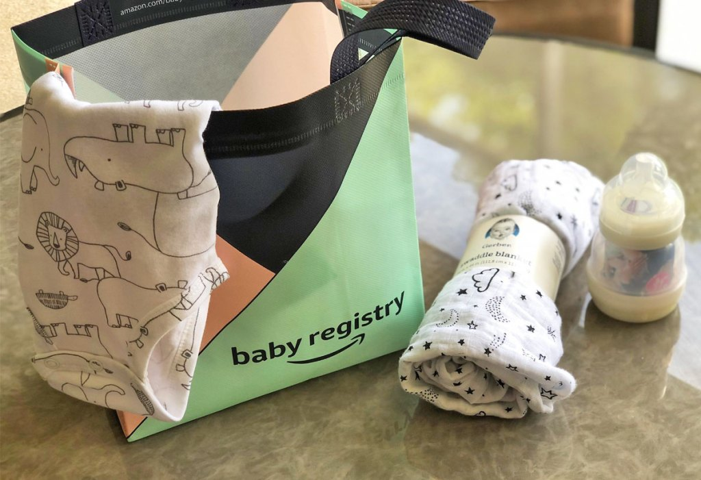 amazone baby registry bag on table with baby items around it