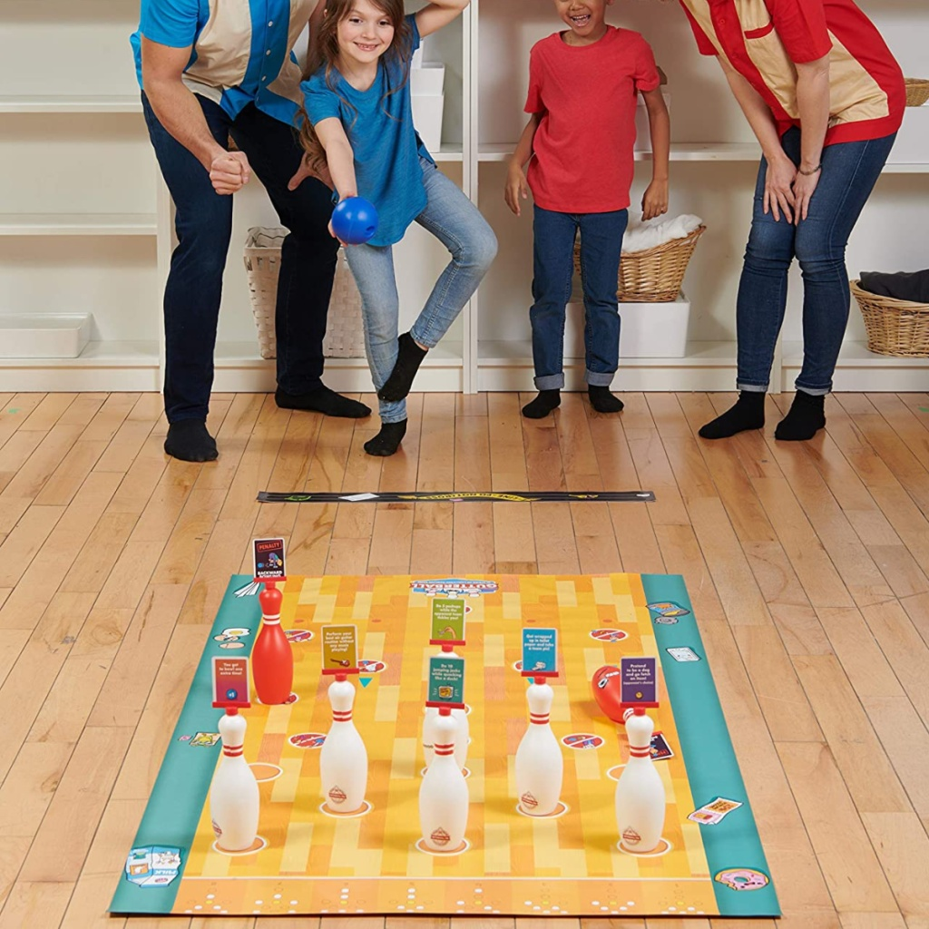 family playing a bowling themed board game!