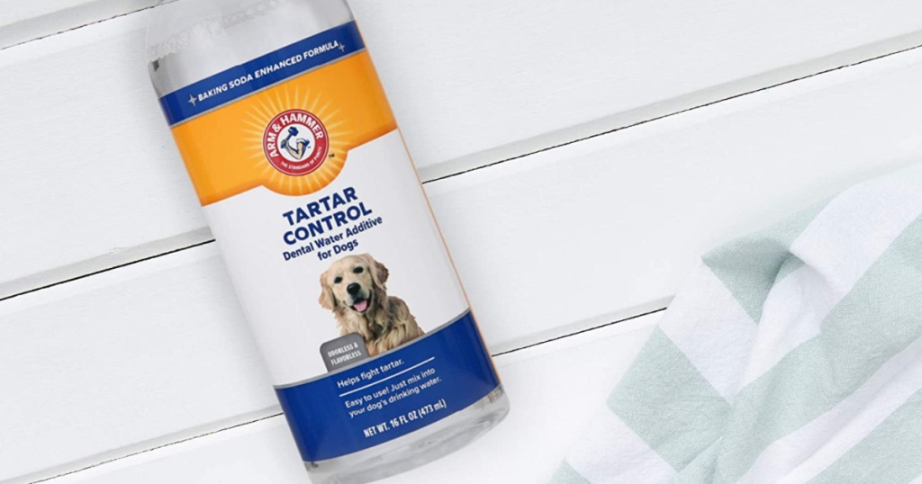 Arm & Hammer Dental Water Additive next to a towel