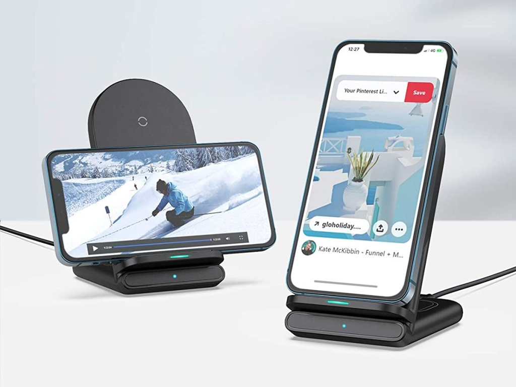 two cell phones on black wireless chargers