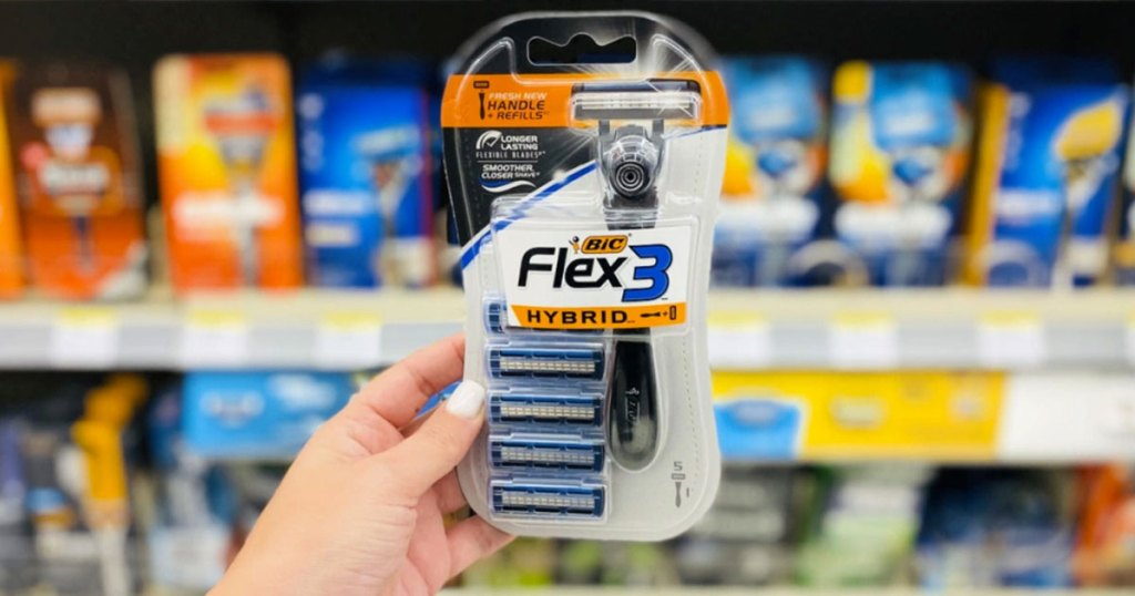woman holding up package of bic flex3 disposable razors