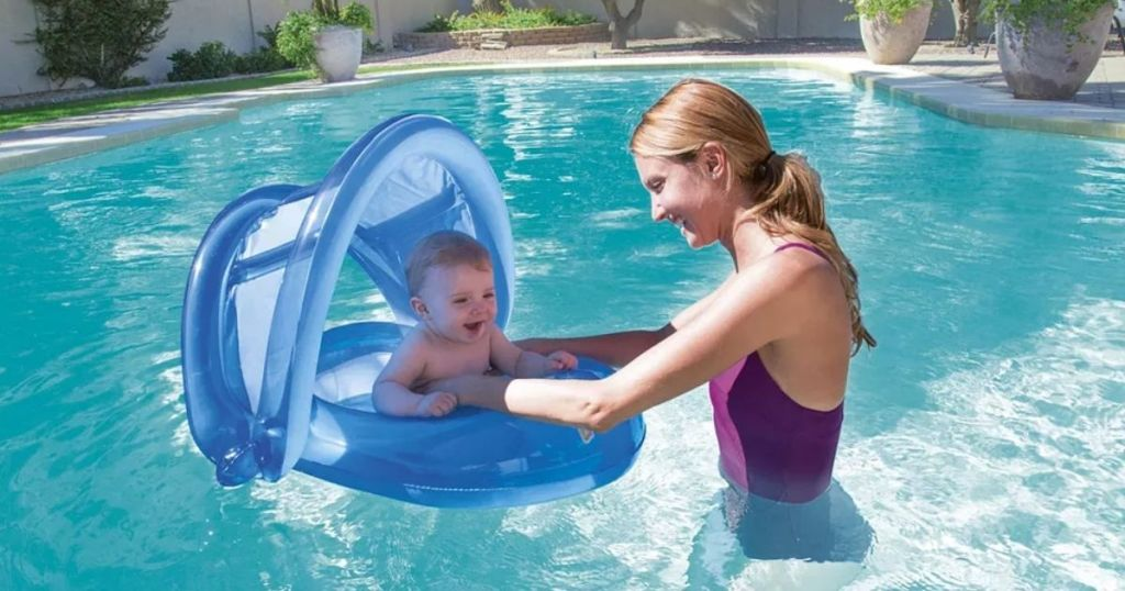 mom and baby in pool with baby floaty