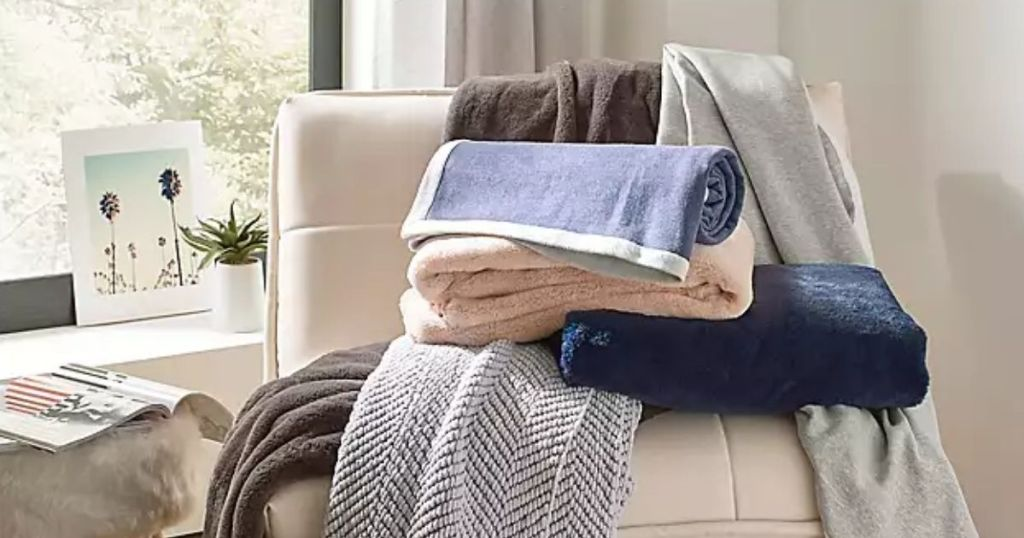 stack of Bed Bath & Beyond UGG Bryce Throw Blanket on a chair