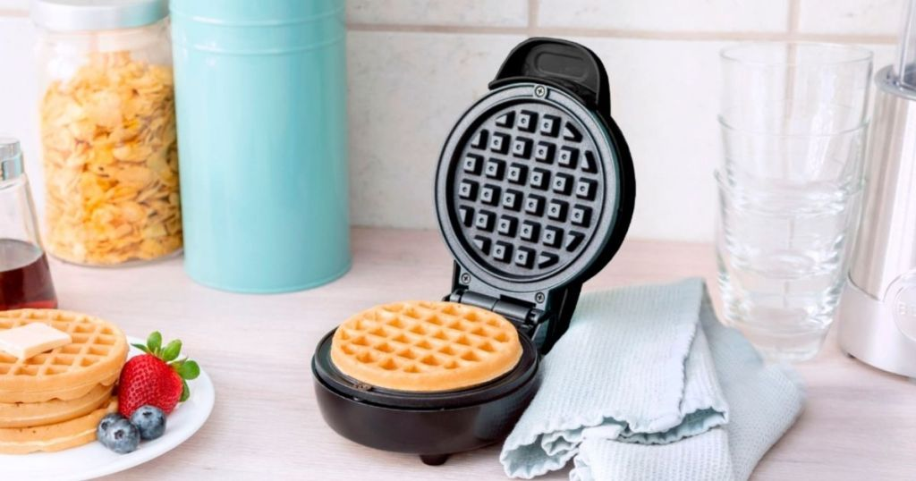 waffle maker open with a waffle in it