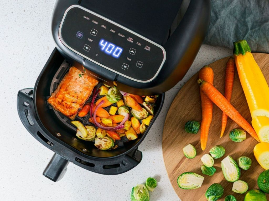 Bella air fryer with basket pulled out filled with food