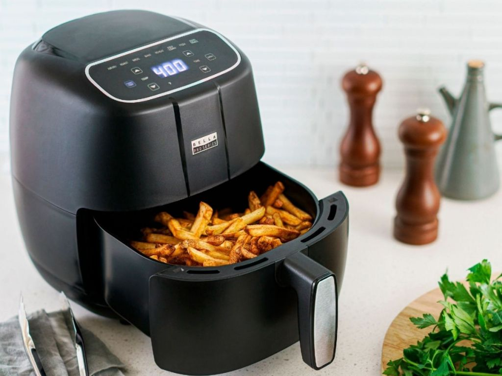 Bella matte black air fryer with basket partially opened filled with fries