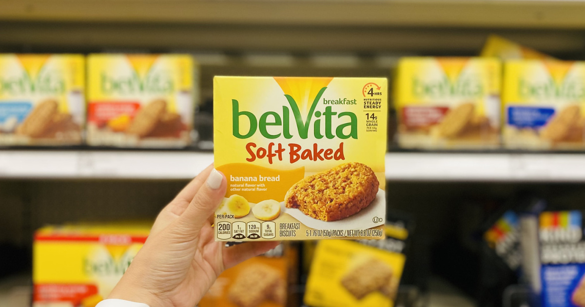 Hand holding up a box of Belvita Soft Baked Biscuits