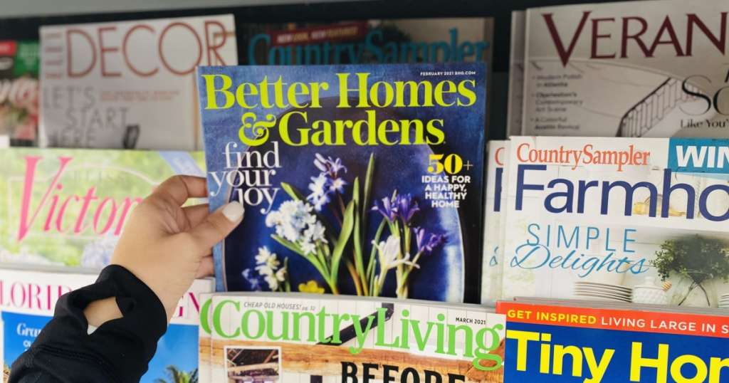 hand holding better homes and gardens magazine