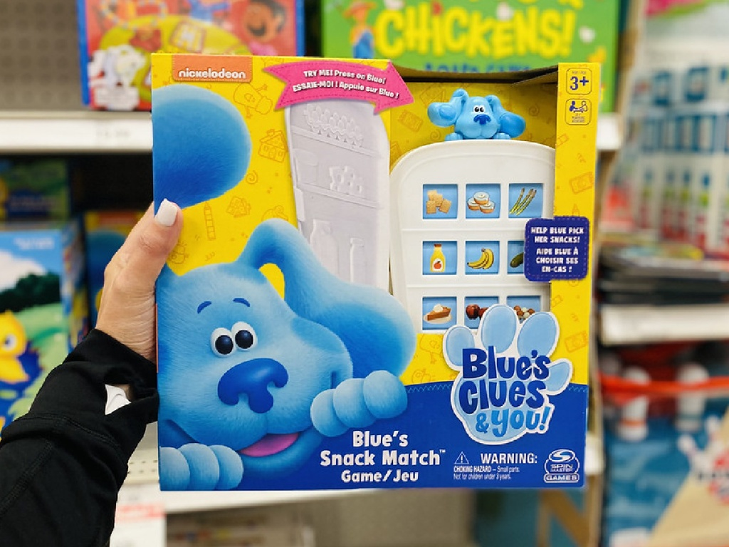 woman's hand holding Blue's Clues board game in store