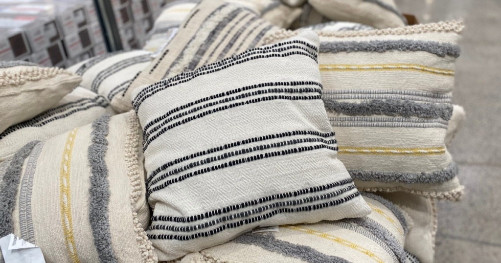 pile of woven pillows in store