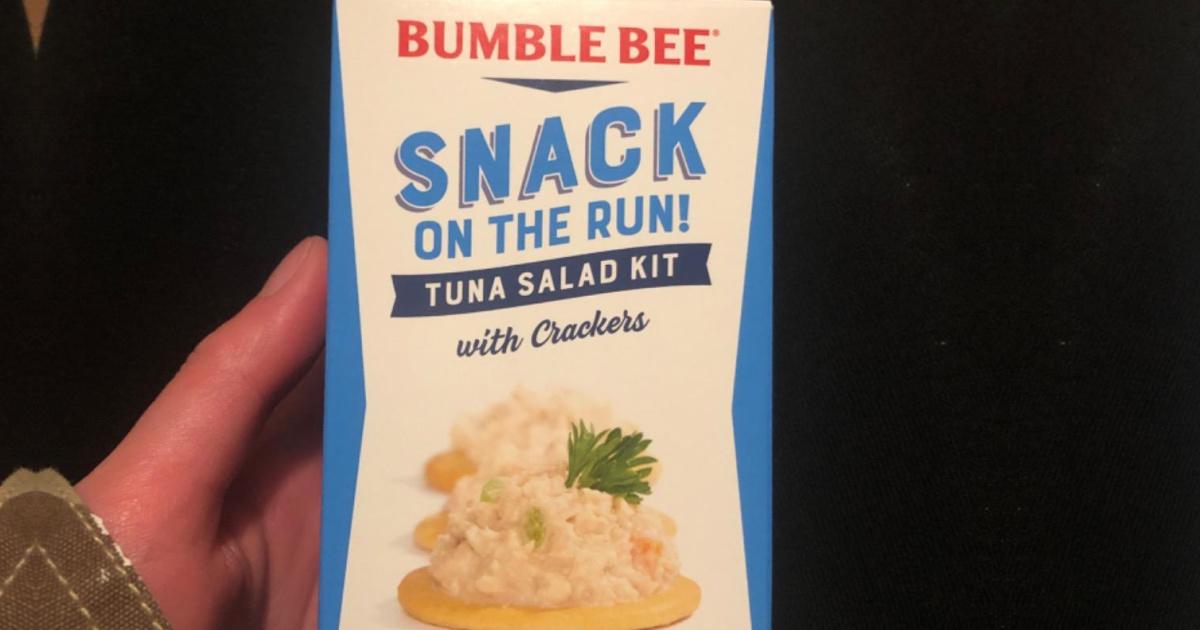 Hand holding a bumble bee tuna salad kit