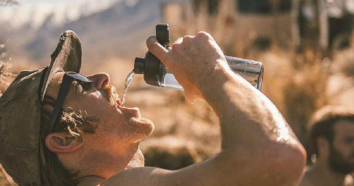 man drinking water from camelBak Chute bottle