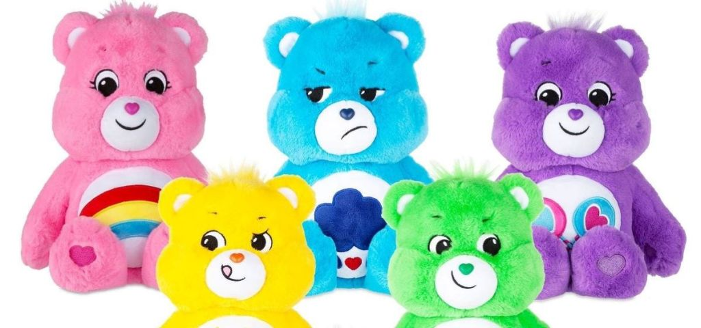 two rows of Care Bears plush toys