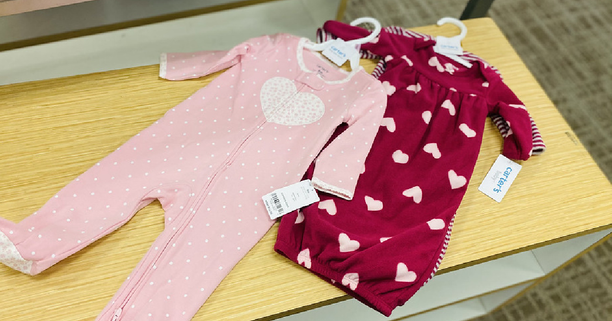 heart themed baby girls clothing on a store table