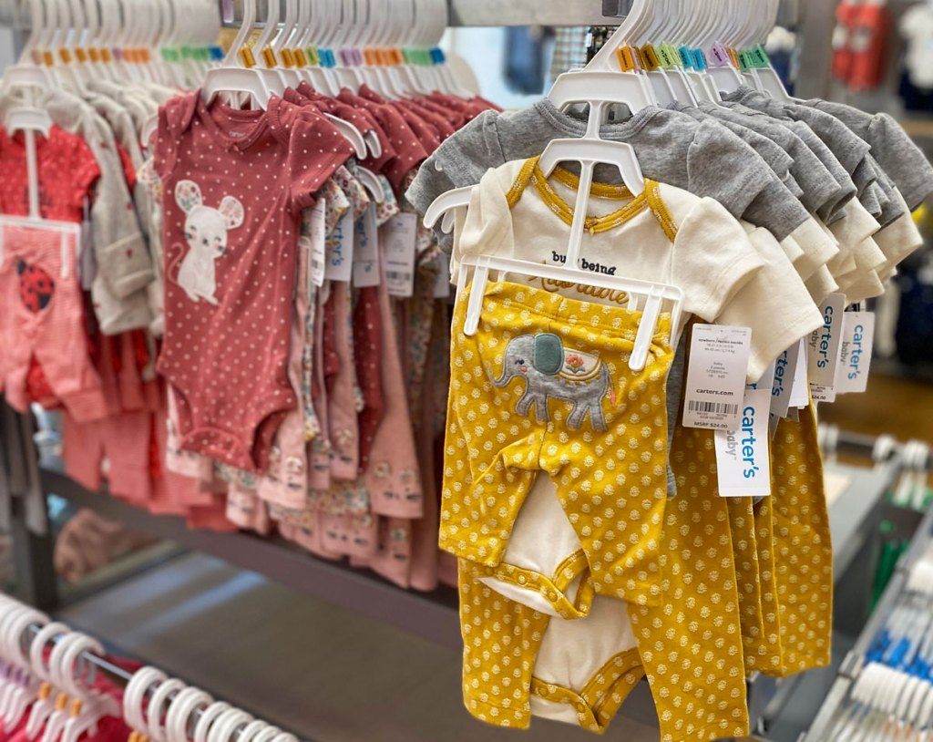 carter's bodysuit and pant sets on store display rack