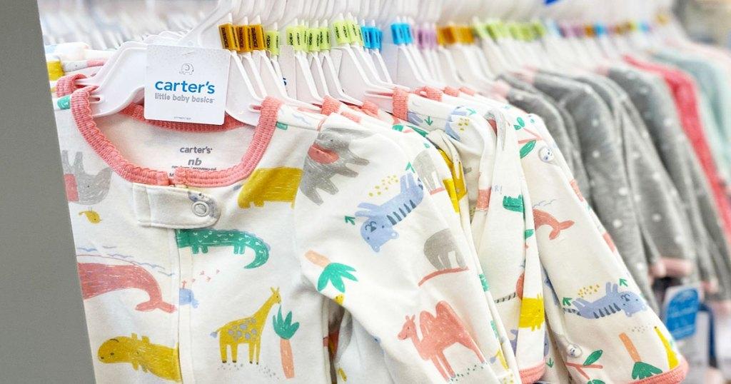 white animal print carter's sleep & plays on store display rack