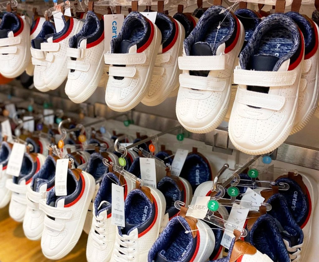 rows of white carter's sneakers