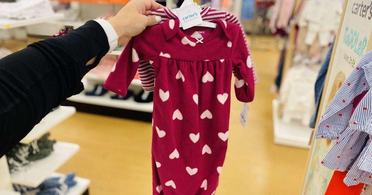 hand holding hanging Carters Valentines Baby PJs