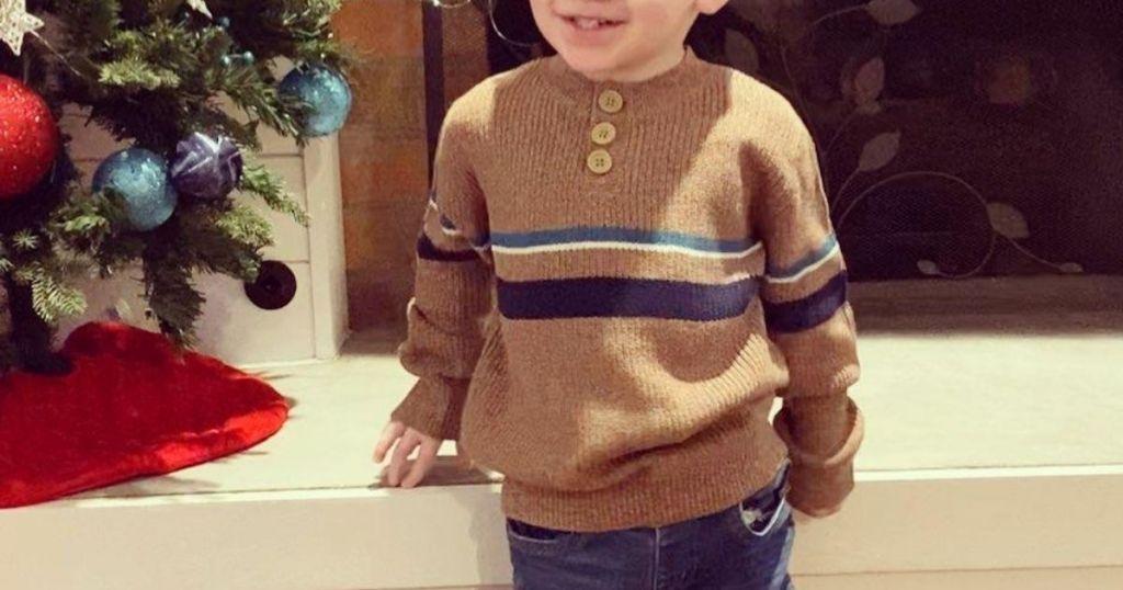 boy wearing Cat & Jack Sweater