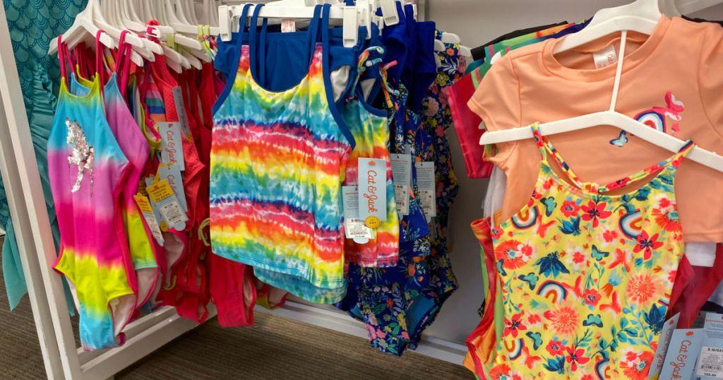 girl's swimsuits on rack