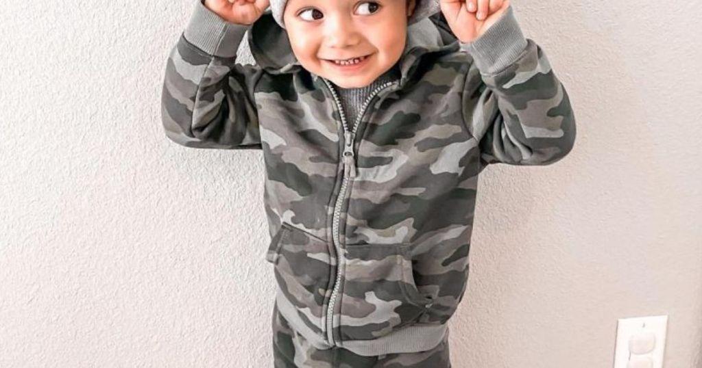 boy wearing Cat & Jack Zip Up Hoodie