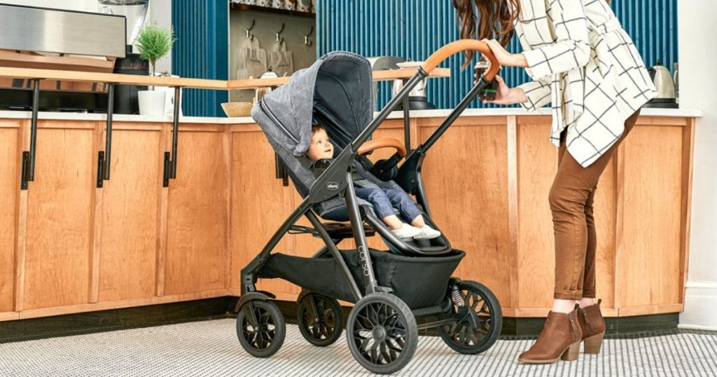 woman looking at baby in Chicco stroller