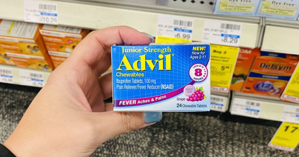 hand holding blue box of advil