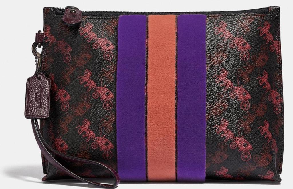 brown, purple, and orange coach purse with horses on it