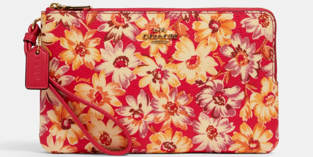 Coach wallet with flowers on it