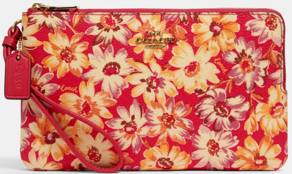 red coach zip wallet with yellow and pink daisies
