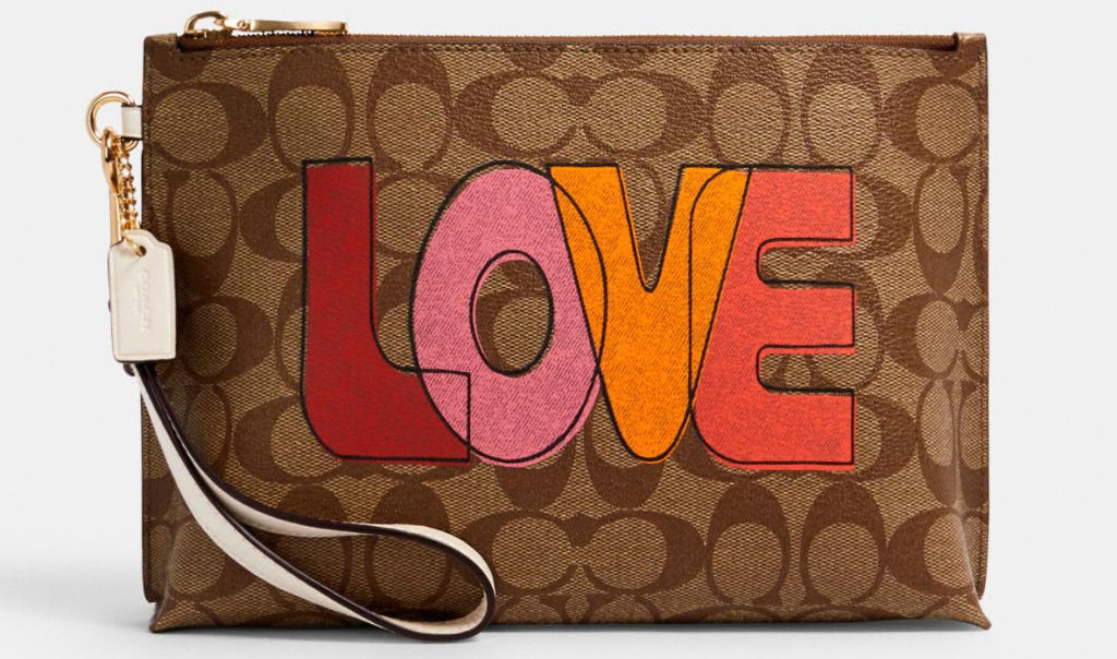 Coach pouch with Love written on it