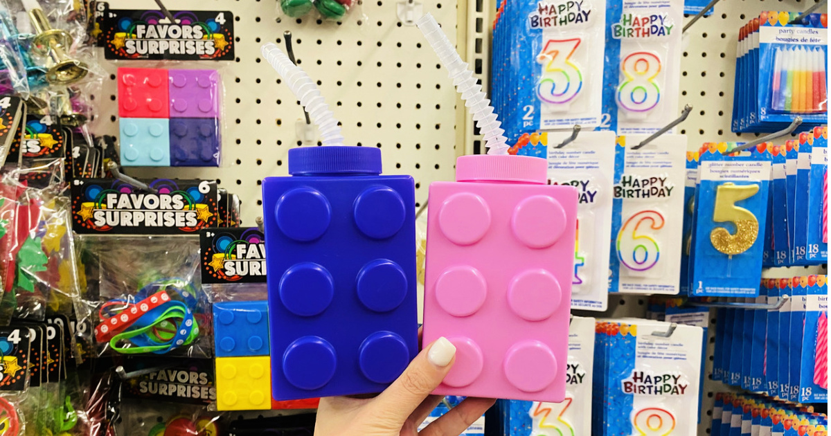 person holding up blue and pink lego Brick Drinking Cups with Straws