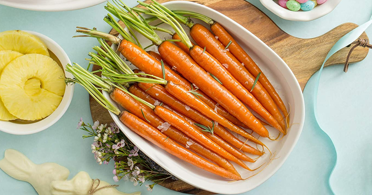 Large casserole dish with carrots on a table