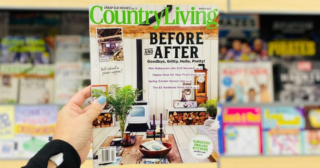 hand holding a Country Living Magazine