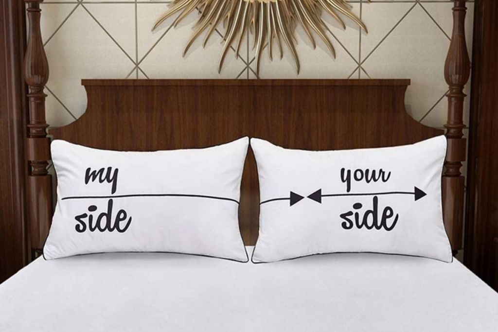 Funny pillowcases displayed on a bed