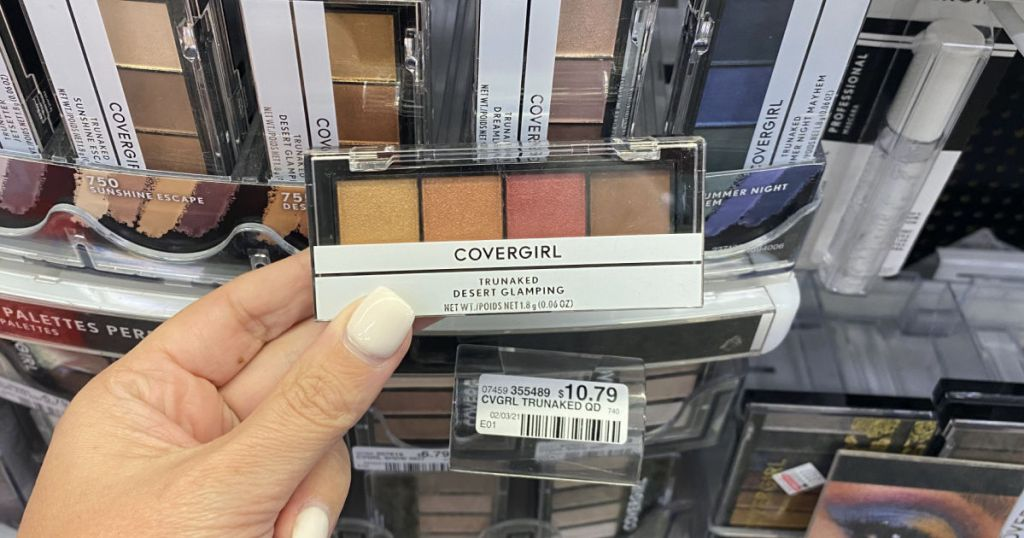 Hand holding eyeshadow palette