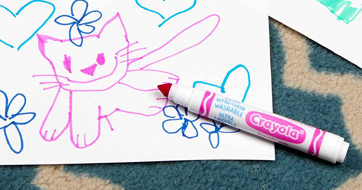 Pink washable marker near a drawing of a cat