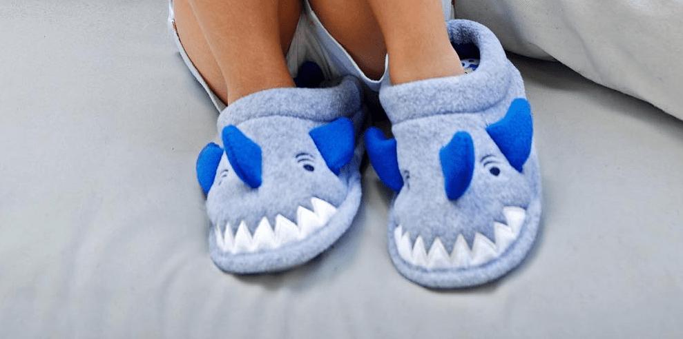 kid wearing shark slippers