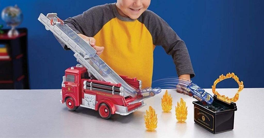 boy playing with Disney Pixar Cars Stunt & Splash Red