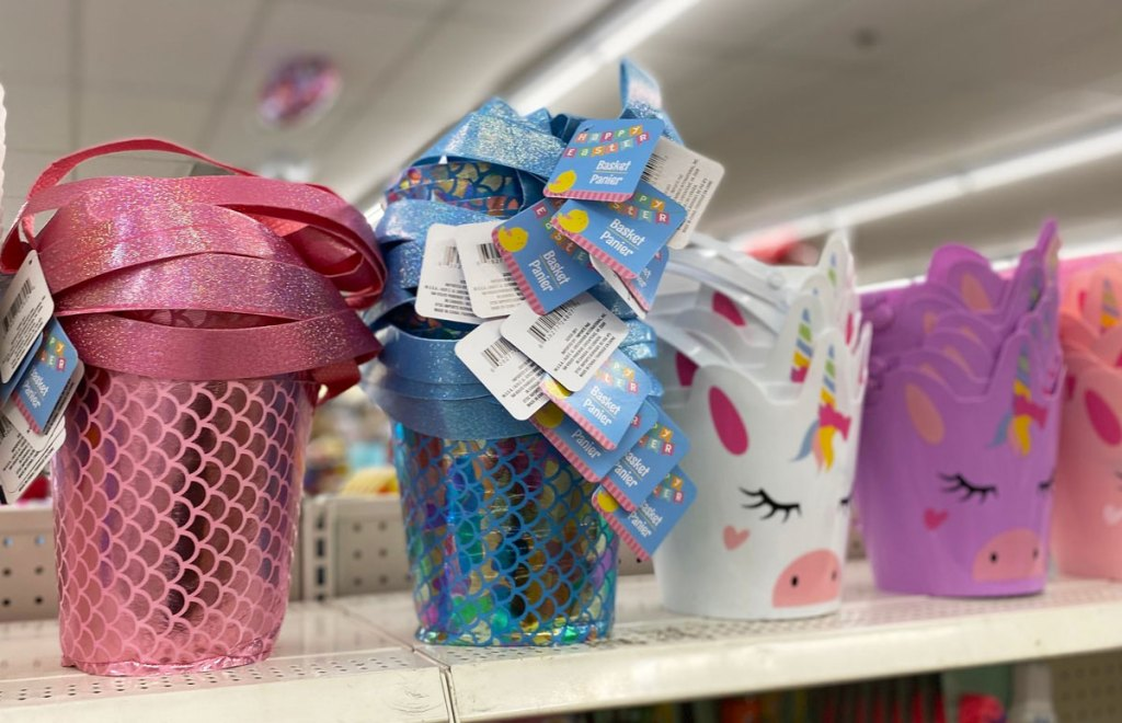mermaid and unicorn themed easter baskets on shelf at dollar tree