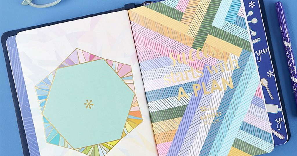 multiple erin condren journals with colorful covers