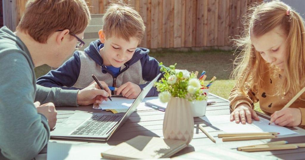 kids doing Evan-Moor Activities outside