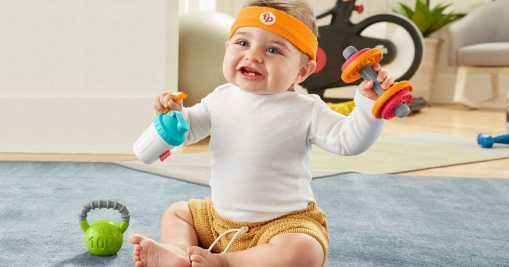 Baby playing with play gym toys