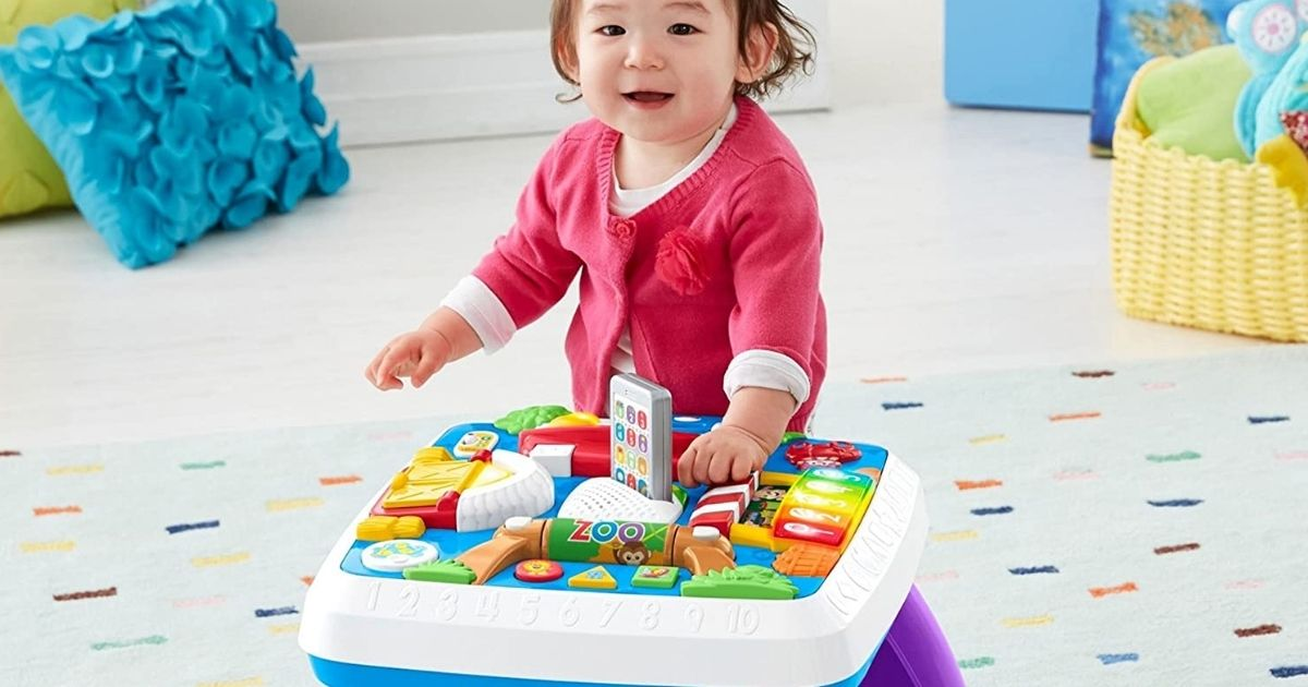 girl playing at a toy table