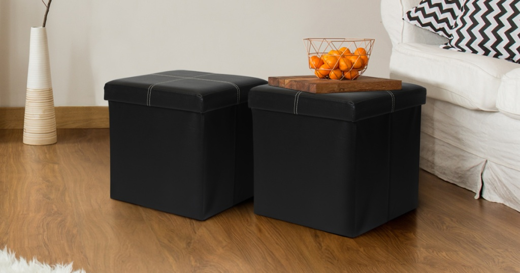 Two faux leather ottomans