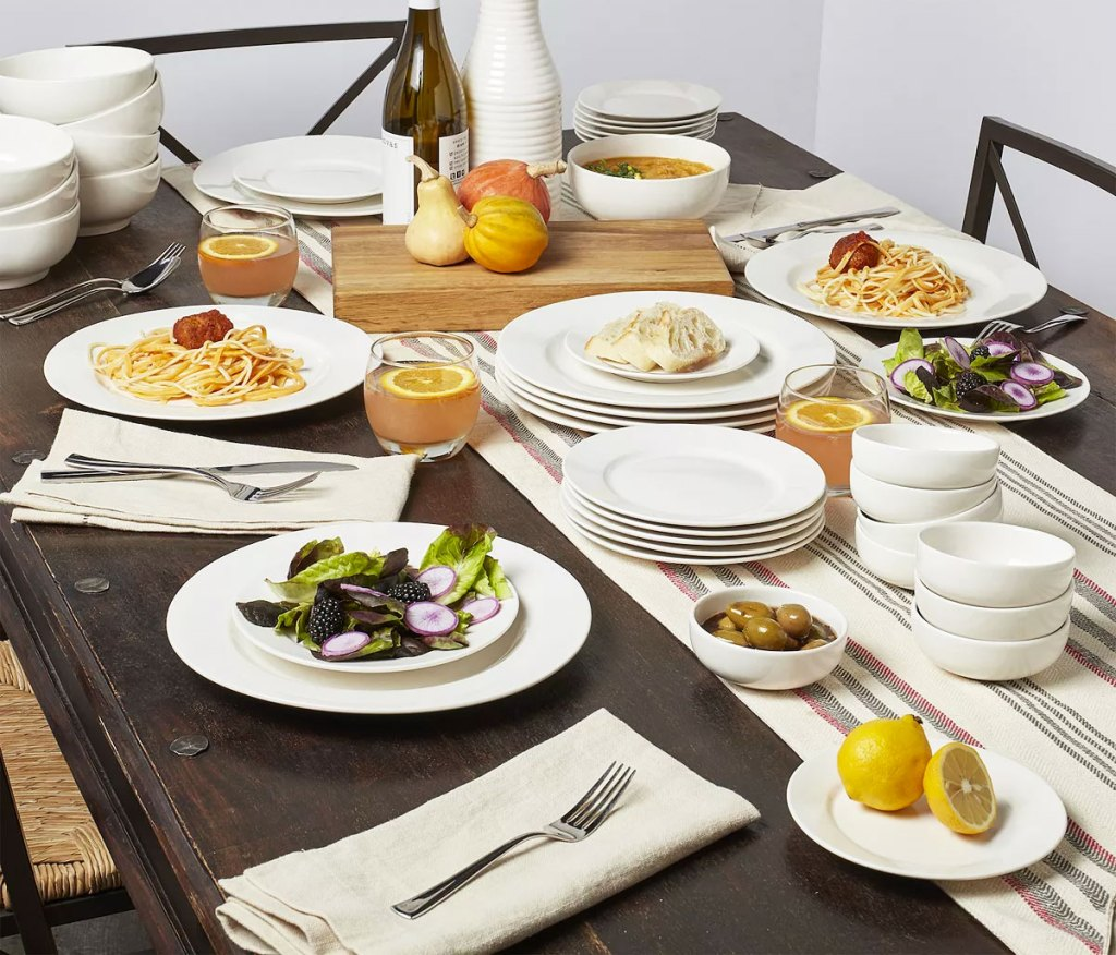 table set with white dinnerware