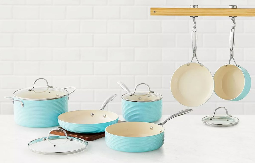 blue and white cookware set on a kitchen counter