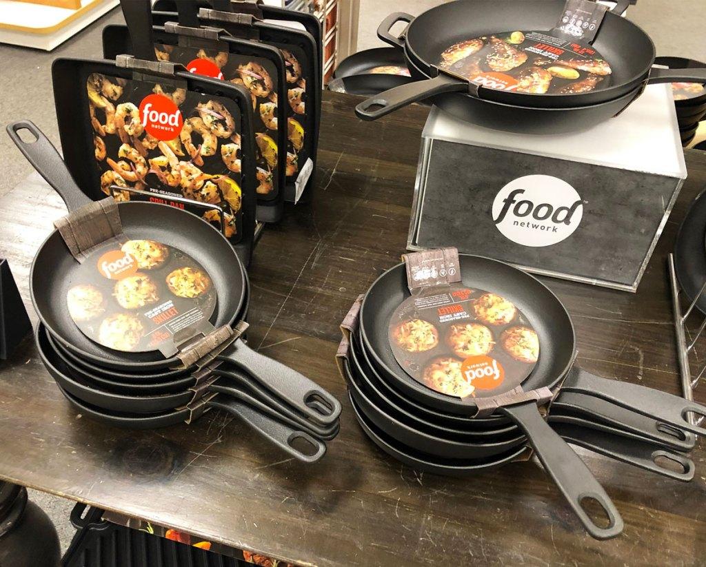 food network cast iron skillets on display table at kohls